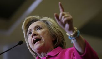 Democratic presidential candidate Hillary Clinton speaks during a campaign rally at the Iowa State Historical Museum, Monday, Jan. 4, 2016, in Des Moines, Iowa. (AP Photo/Charlie Neibergall)