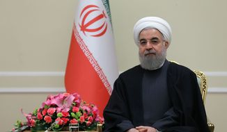 """In this photo released by the official website of the office of the Iranian Presidency, Iran's President Hassan Rouhani sits during a meeting with Danish Foreign Minister Kristian Jensen in Tehran, Iran, Tuesday, Jan. 5, 2016. Iran's president said on Tuesday that Saudi Arabia cannot """"cover up"""" its crime of executing a leading Shiite cleric by severing diplomatic relations with the Islamic Republic, even as the kingdom's allies began limiting their links to his country. (Iranian Presidency Office via AP)"""