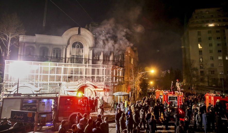 In this Sunday, Jan. 3, 2016, file photo, smoke rises as Iranian protesters, upset over the execution of Shiite cleric Nimr al-Nimr in Saudi Arabia, set fire to the Saudi embassy in Tehran, Iran.  (Mohammadreza Nadimi/ISNA via AP, File)
