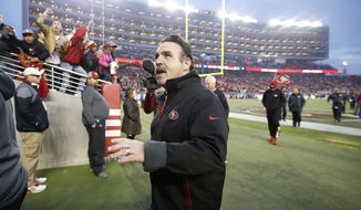 San Francisco 49ers head coach Jim Tomsula waves to fans as he walks off the field after an NFL football game against the St. Louis Rams in Santa Clara, Calif., Sunday, Jan. 3, 2016. (AP Photo/Tony Avelar)
