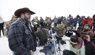 Ammon Bundy, one of the sons of Nevada rancher Cliven Bundy, speaks with reporters during a news conference at Malheur National Wildlife Refuge headquarters Tuesday, Jan. 5, 2016, near Burns, Ore. Law enforcement had yet to take any action Tuesday against a group numbering close to two dozen, led by Bundy and his brother, who are upset over federal land policy. (AP Photo/Rick Bowmer)