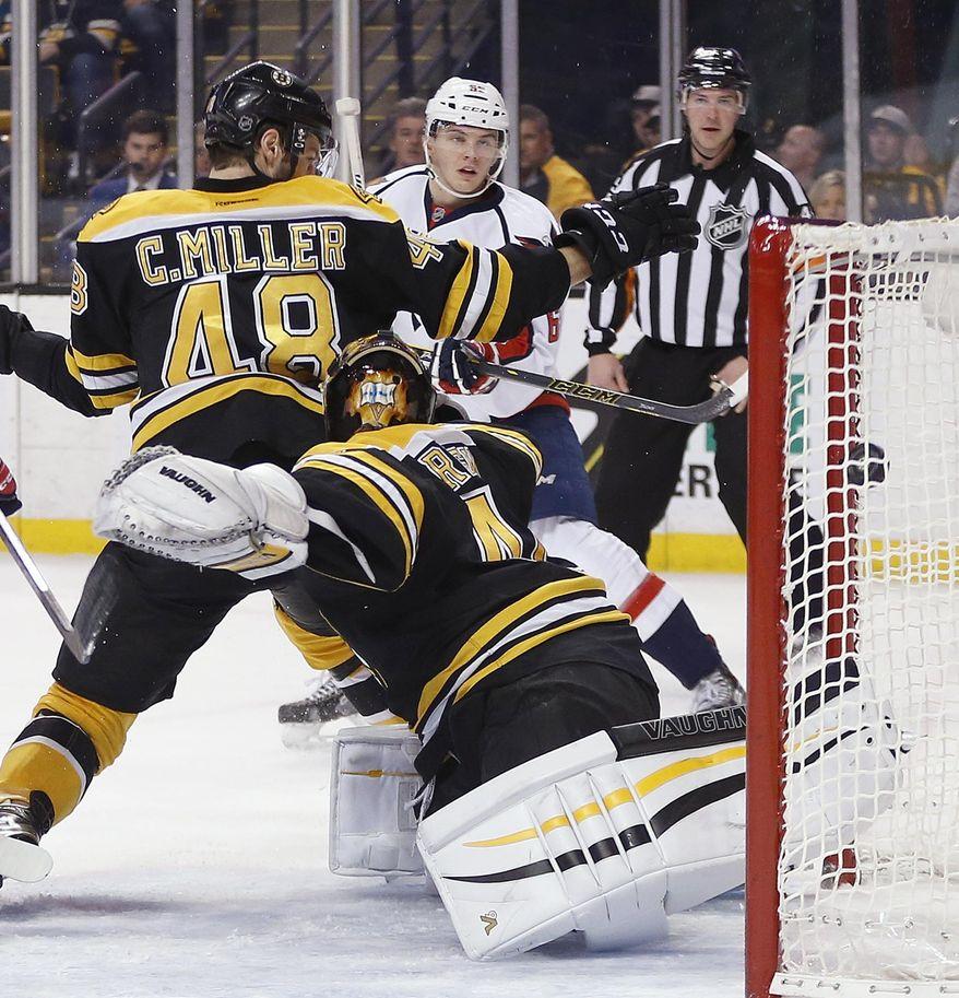 Washington Capitals' Andre Burakovsky, rear, scores on Boston Bruins goalie Tuukka Rask (40) during the first period of an NHL hockey game in Boston, Tuesday, Jan. 5, 2016. (AP Photo/Michael Dwyer)