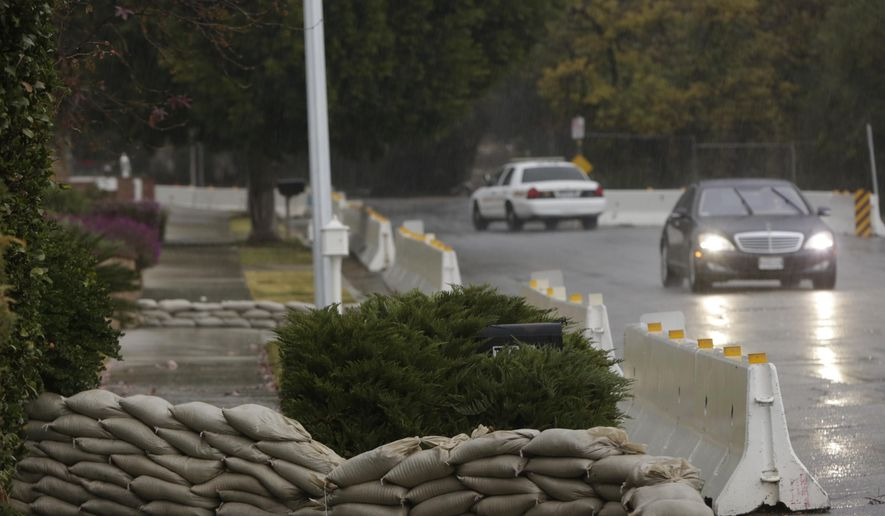 Concrete barriers are set to protect homes from flash flooding in Glendora, Calif., on Tuesday, Jan. 5, 2016. Persistent wet conditions could put some Los Angeles County communities at risk of flash flooding along with mud and debris flows, especially in wildfire burn areas. El Nino storms lined up in the Pacific, promising to drench parts of the West for more than two weeks and increasing fears of mudslides and flash floods in regions stripped bare by wildfires. (AP Photo/Damian Dovarganes)