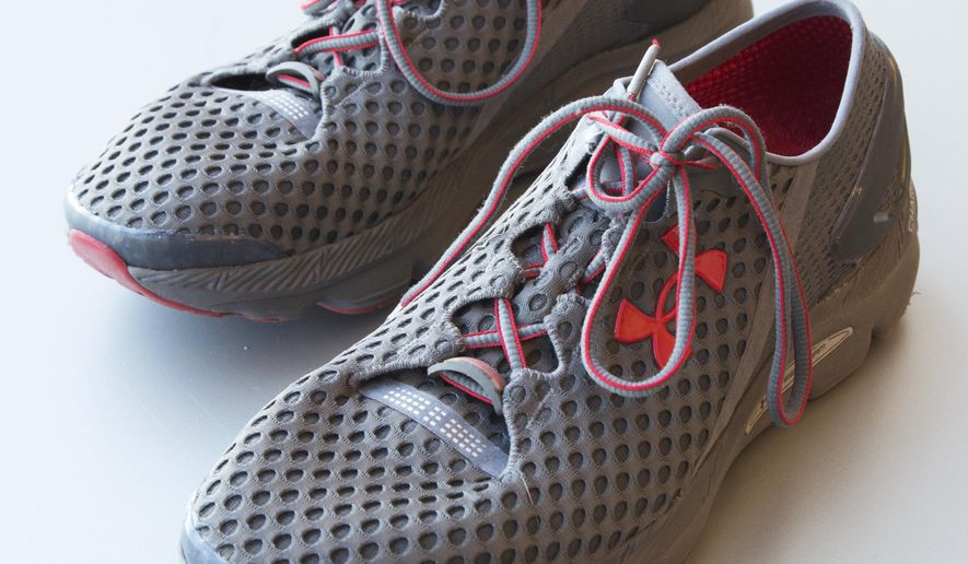 In this Monday, Jan. 4, 2016, photo, a pair of Under Armour SpeedForm Gemini 2 Record Equipped running shoes are displayed in New York. The shoes contain an embedded chip to track exercise. (AP Photo/Mark Lennihan)