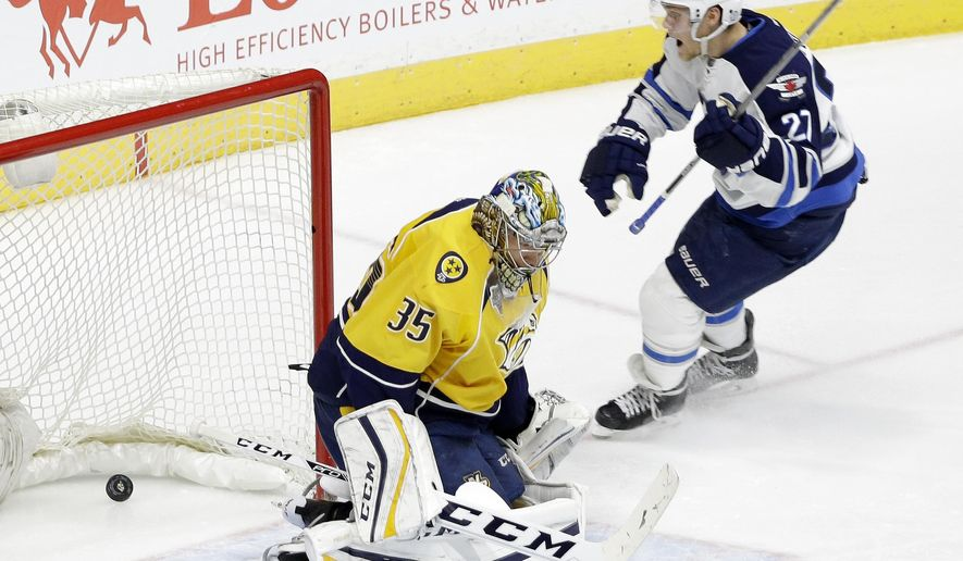 Winnipeg Jets left wing Nikolaj Ehlers (27), of Denmark, celebrates a goal by teammate Ben Chiarot, not shown, against Nashville Predators goalie Pekka Rinne (35), of Finland, in the third period of an NHL hockey game Tuesday, Jan. 5, 2016, in Nashville, Tenn. (AP Photo/Mark Humphrey)