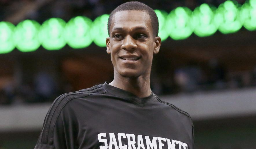 Sacramento Kings guard Rajon Rondo looks on from the sidelines during the first half of the Kings' NBA basketball game against the Dallas Mavericks on Tuesday, Jan. 5, 2016, in Dallas. (AP Photo/LM Otero)