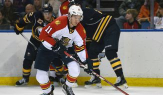 Florida Panthers left winger Jonathan Huberdeau (11) skates away with the puck after a battle along the boards during the second period of an NHL hockey game against the Buffalo Sabres, Tuesday, Jan. 5, 2016 in Buffalo, N.Y. (AP Photo/Gary Wiepert)