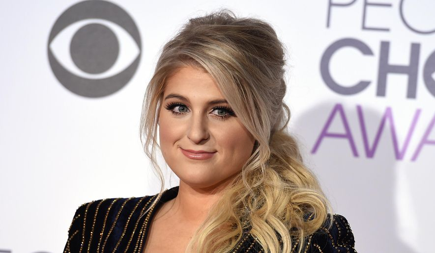 Meghan Trainor arrives at the People's Choice Awards at the Microsoft Theater on Wednesday, Jan. 6, 2016, in Los Angeles. (Photo by Jordan Strauss/Invision/AP) ** FILE **
