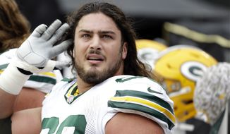 Green Bay Packers' David Bakhtiari (69) on the sidelines against the Carolina Panthers during the first half of an NFL football game in Charlotte, N.C., Sunday, Nov. 8, 2015. The Panthers won 37-29. (AP Photo/Bob Leverone)