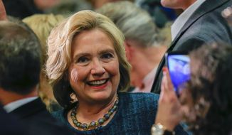 Democratic presidential candidate Hillary Clinton poses for a picture with a supporter following a campaign stop at Iowa Western Community College in Council Bluffs, Iowa, Tuesday, Jan. 5, 2016. (AP Photo/Nati Harnik)