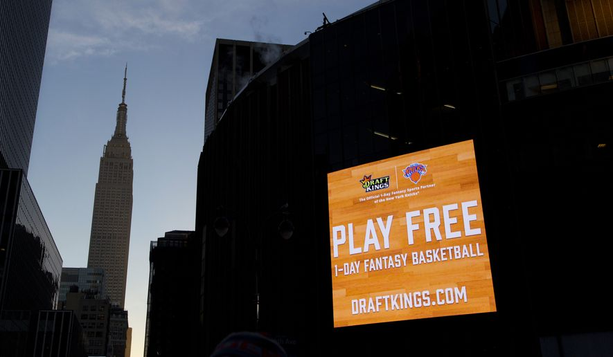 An electronic advertisement for DraftKings hangs on the side of Madison Square Garden, Wednesday, Jan. 6, 2016 in New York. Officials say a court could rule by mid-January in the legal spat between fantasy sports sites FanDuel and DraftKings over a state order to shut down their operations in New York. The companies have asked an appeals court to continue a temporary hold on Attorney General Eric Schneiderman's shutdown order. The companies argue their games are based on skill, not chance, and players pay entry fees in order to manage rosters like a general manager. But Schneiderman has countered that the games are highly dependent on factors out of their control, such as injuries or even the weather, and are thus ultimately based on chance. (AP Photo/Mark Lennihan)