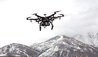 Members of the Box Elder County Sheriff's Office fly their search and rescue drone during a demonstration in Brigham City, Utah, on Feb. 13, 2014. (Associated Press)