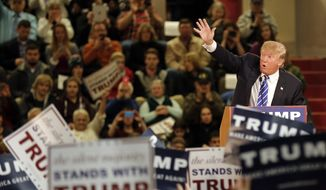 Republican presidential candidate Donald Trump waves to a cheering crowd during a campaign stop Tuesday, Jan. 5, 2016, in Claremont, N.H. (AP Photo/Jim Cole)