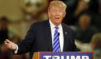 Republican presidential candidate Donald Trump speaks to a crowd during a campaign stop Tuesday, Jan. 5, 2016, in Claremont, N.H. (AP Photo/Jim Cole)