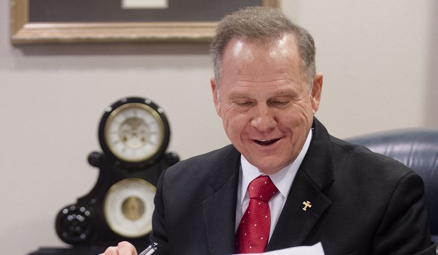 Alabama Chief Justice Roy Moore reads his administrative order discouraging probate judges from issuing same sex marriage licenses, Wednesday, Jan. 6, 2016, at the Alabama Supreme Court building in Montgomery, Ala. The outspoken chief justice, who previously tried to block gay marriage from coming to the Deep South state, issued an administrative order Wednesday saying the Alabama Supreme Court never lifted a March 2015 directive to probate judges to refuse licenses to gay couples.  (Albert Cesare/The Montgomery Advertiser via AP)