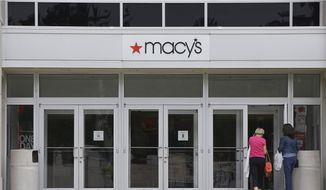 Shoppers walk into a Macy's department store at the Hanover Mall in Hanover, Mass., in this July 10, 2015, file photo. Macy's is cutting up to about 4,800 jobs after disappointing holiday sales. The company also listed Wednesday, Jan. 6, 2016, which 40 stores it would close. It had announced it was closing stores in September. (AP Photo/Stephan Savoia, File)