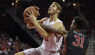 Maryland forward Jake Layman (10) is fouled by Rutgers guard Omari Grier (31) during the second half of an NCAA college basketball game Wednesday, Jan. 6, 2016, in College Park, Md. Maryland won 88-63. (AP Photo/Nick Wass)