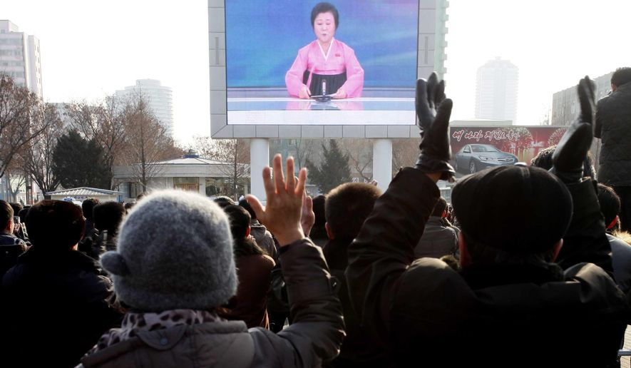 North Koreans watch a news broadcast on a video screen outside Pyongyang Railway Station in Pyongyang, North Korea, Wednesday, Jan. 6, 2016. North Korea said Wednesday it had conducted a hydrogen bomb test, a defiant and surprising move that, if confirmed, would put Pyongyang a big step closer toward improving its still-limited nuclear arsenal. (AP Photo/Kim Kwang Hyon)