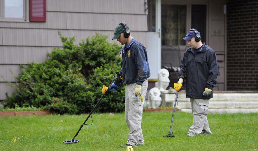 FILE - In this Thursday, May 10, 2012, file photo, law enforcement agents search the yard at the home of reputed Connecticut mobster Robert Gentile in Manchester, Conn. Gentile, suspected of having knowledge about long-sought stolen artwork, is due to appear in court in an attempt to get a weapons case dismissed on Wednesday, Jan. 6, 2016. (AP Photo/Jessica Hill, File)