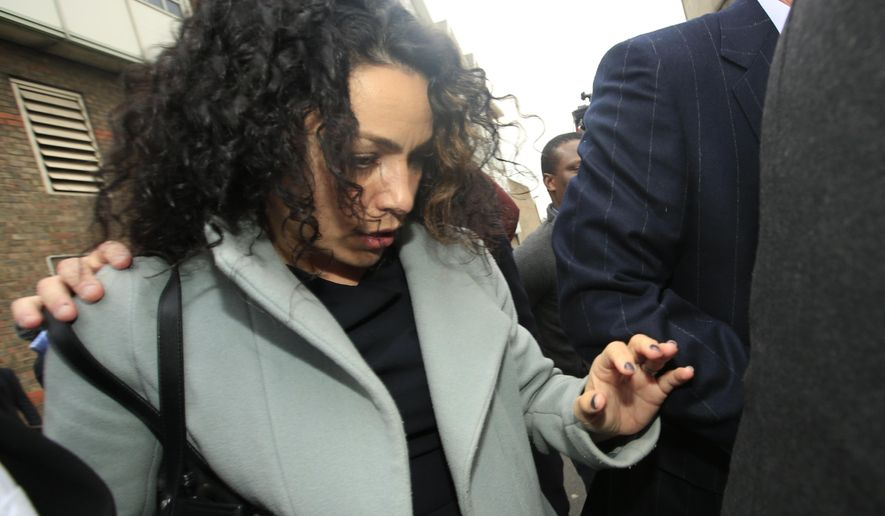 Former Chelsea soccer team doctor Eva Carneiro leaves an unfair dismissal hearing in Croydon south London, Wednesday, Jan. 6, 2016. Carneiro is claiming against Chelsea, with this initial hearing to sort out legal positions, list witnesses and documents, while a full hearing will happen around June. (AP Photo/Alastair Grant)