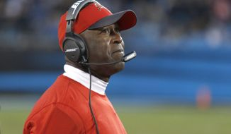 FILE - In this Jan. 3, 2016, file photo, Tampa Bay Buccaneers coach Lovie Smith watches his team take on the Carolina Panthers during an NFL football game in Charlotte, N.C. The Buccaneers fired Smith on Wednesday night, Jan. 6. Smith went 6-10 this year and 8-24 over two seasons in charge of the team. (AP Photo/Bob Leverone, File)
