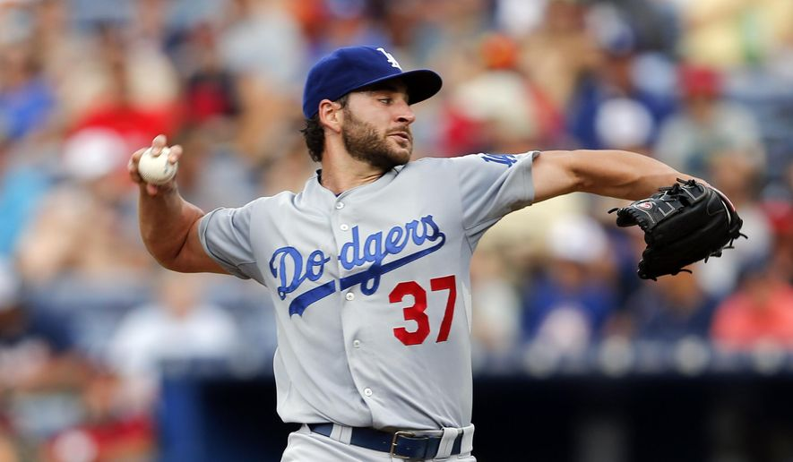 FILE - In this July 20, 2015, file photo, Los Angeles Dodgers starting pitcher Brandon Beachy works against the Atlanta Braves in the first inning of a baseball game, in Atlanta. Free-agent pitcher Brandon Beachy and the Los Angeles Dodgers have agreed to a $1.5 million, one-year contract. (AP Photo/John Bazemore, File)
