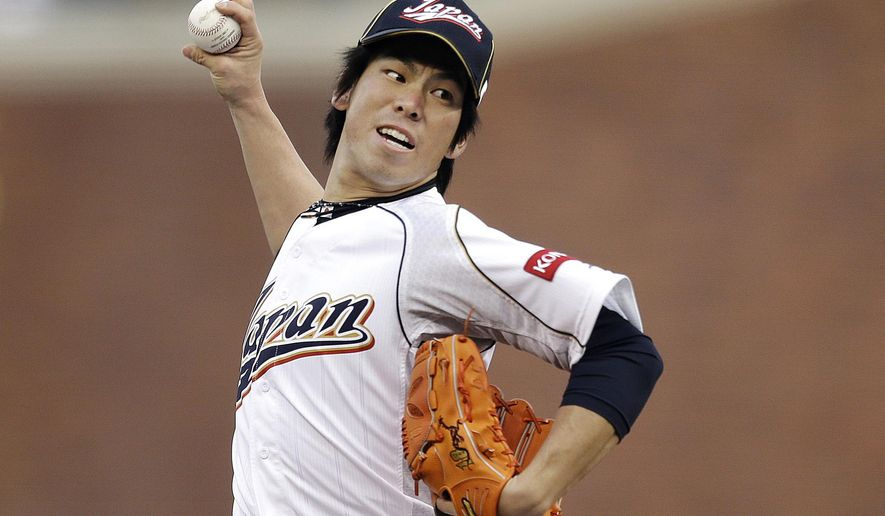 FILE - In this Sunday, March 17, 2013 file photo, Japan's Kenta Maeda pitches during the first inning of a semifinal game of the World Baseball Classic against Puerto Rico in San Francisco. The Dodgers are set to announce the signing of free-agent Japanese pitcher Kenta Maeda. Los Angeles scheduled a news conference on Thursday, Jan. 7, 2016 at Dodger Stadium, and a person familiar with the event said the subject of the news conference was Maeda.(AP Photo/Ben Margot, File)