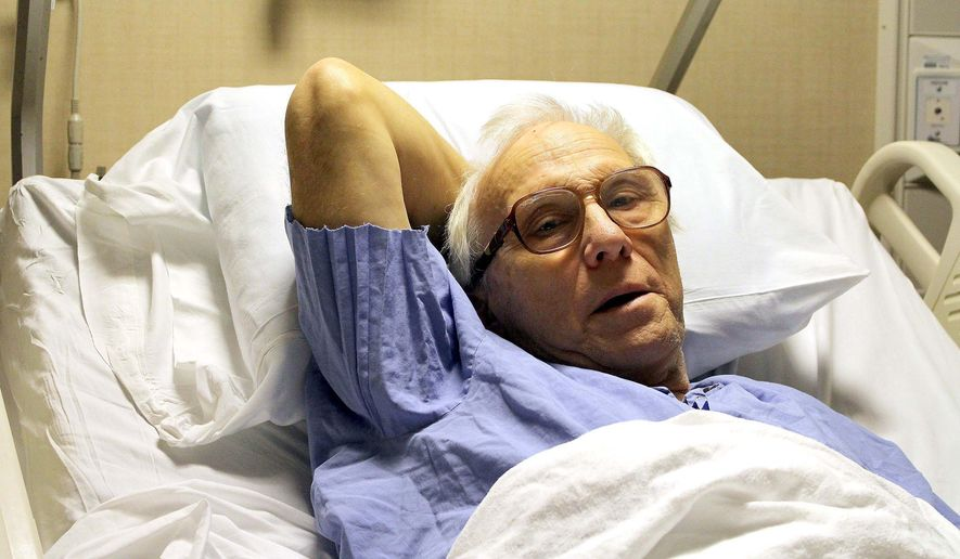 In this photo taken Dec. 23, 2015, Dr. Richard Olson recuperates at the Mayo Cinic Hospital- Saint Mary's Campus in Rochester, Minn., after a surviving a hunting accident in North Dakota. Olson suffered a broken leg on Dec. 19, 2015, and crawled 16 hours across frozen terrain back to his vehicle where he was rescued by a passerby. (Josh Moniz/The Rochester Post-Bulletin via AP) MANDATORY CREDIT