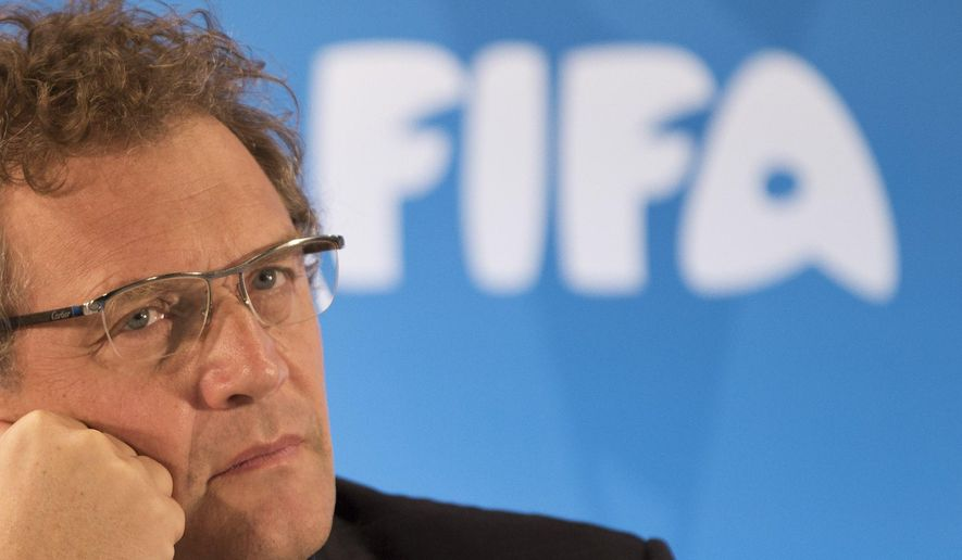 FILE -  In this Thursday, Jan. 23, 2014 file photo FIFA Secretary General Jerome Valcke listen to questions during a news conference to present the new world cup song at the Maracana stadium in Rio de Janeiro, Brazil. FIFA's ethics investigator Cornel Borbely recommended Tuesday Jan. 5, 2016 a 9-year ban for suspended secretary general Jerome Valcke. (AP Photo/Felipe Dana, File)