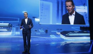 Herbert Diess, chairman of the board of Volkswagen Brand, speaks during a keynote address at CES International, Tuesday, Jan. 5, 2016, in Las Vegas. (AP Photo/John Locher)