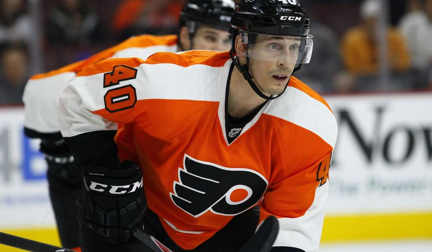 FILE - In this Tuesday, April 7, 2015 file photo, Philadelphia Flyers' Vincent Lecavalier waits for the puck during an NHL hockey game in Philadelphia. Vincent Lecavalier is ready for one more run at the Stanley Cup, and the Los Angeles Kings are giving him a chance. The Kings acquired Lecavalier and defenseman Luke Schenn from the Philadelphia Flyers on Wednesday, Jan. 6, 2016 in a trade for center Jordan Weal and a third-round pick.(AP Photo/Tom Mihalek, File)