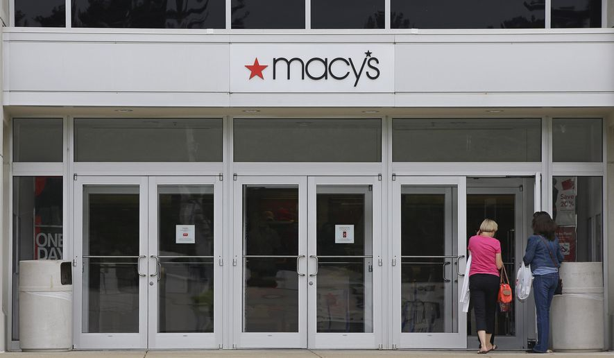 FILE - In this July 10, 2015, file photo, shoppers walk into a Macy's department store at the Hanover Mall in Hanover, Mass. Macy's is cutting up to about 4,800 jobs after disappointing holiday sales. The company also listed Wednesday, Jan. 6, 2016, which 40 stores it would close. It had announced it was closing stores in September. (AP Photo/Stephan Savoia, File)
