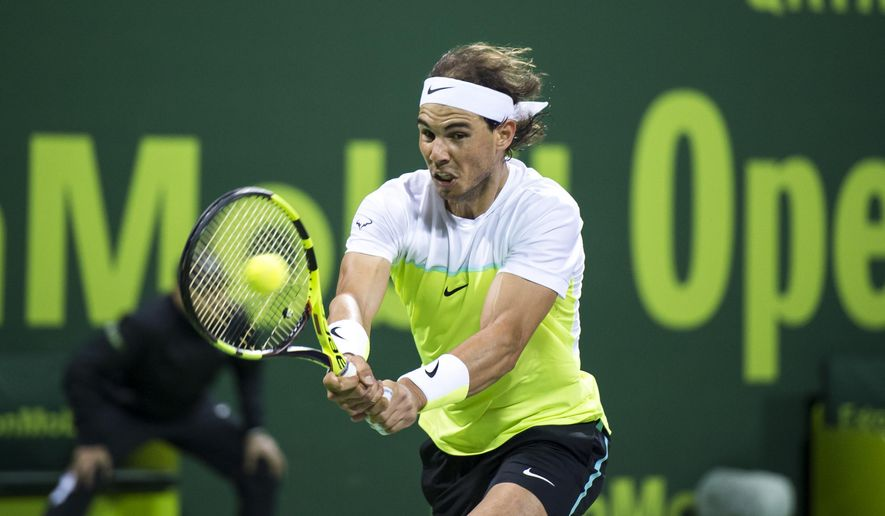 Spain's Rafael Nadal returns the ball during a match against Robin Haase of Netherland at Qatar Open Tennis tournament Wednesday, Jan. 6, 2016, in Doha, Qatar. (AP Photo/Alexandra Panagiotidou)