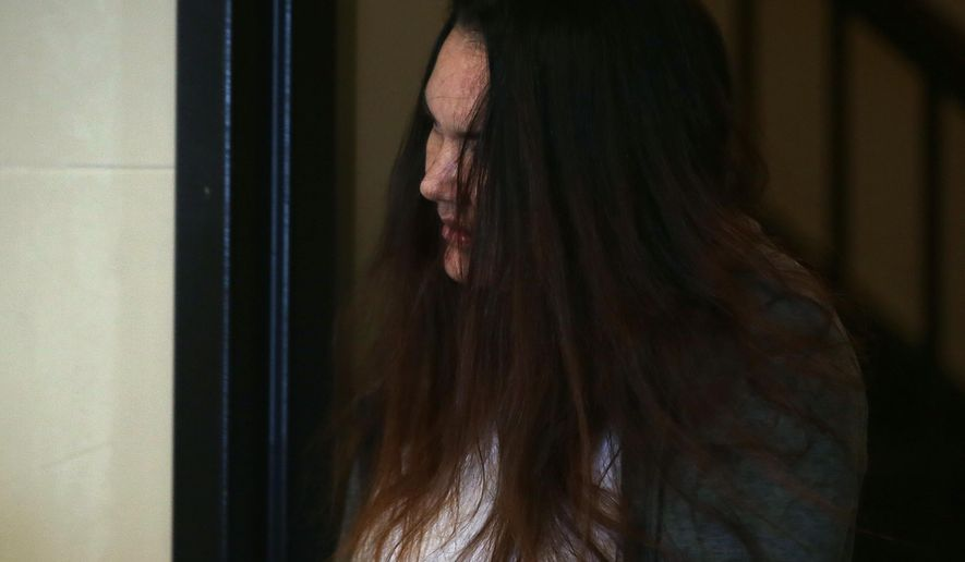 Rachelle Bond arrives in Suffolk Superior Court, to appear before Magistrate Edward J. Curley, on Wednesday, Jan. 6, 2016 in Boston, Mass. According to the Suffolk County District Attorney's Office, Bond was arraigned Wednesday on charges she helped her boyfriend conceal the body of her daughter, Bella. Bond, mother of a 2-year-old girl dubbed Baby Doe after her body washed up on a Boston Harbor island inside a bag, pleaded not guilty to an accessory charge connected to the toddler's death. Michael McCarthy was charged with first-degree murder and will be arraigned Monday. (Pat Greenhouse/The Boston Globe via AP, Pool)