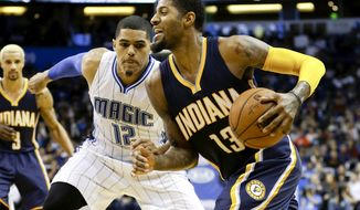 Indiana Pacers' Paul George (13) drives around Orlando Magic's Tobias Harris (12) during the second half of an NBA basketball game, Wednesday, Jan. 6, 2016, in Orlando, Fla. Indiana won 95-86. (AP Photo/John Raoux)