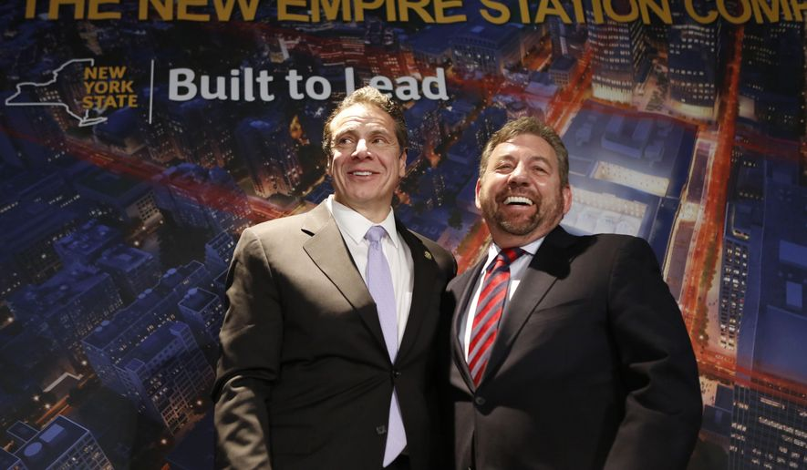 New York Governor Andrew Cuomo, left, poses for a photo with Madison Square Garden Executive Chairman James Dolan, Wednesday, Jan. 6, 2016, after a press conference announcing that work will commence immediately on the overhaul of Pennsylvania Station in New York.  (AP Photo/Kathy Willens)