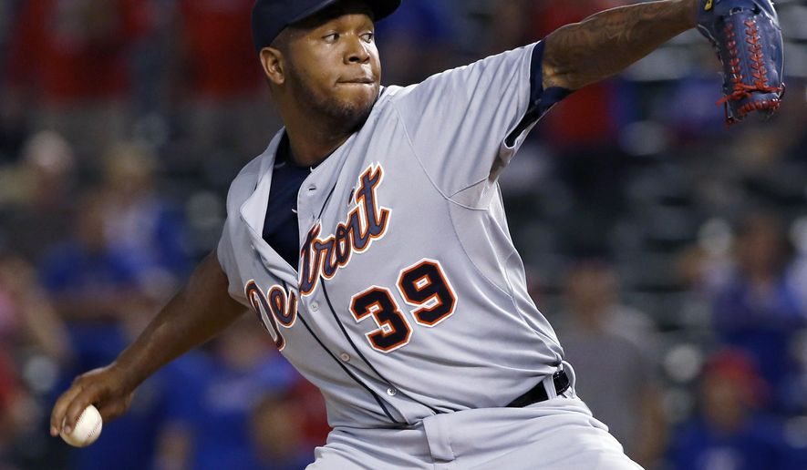 This Sept. 28, 2015 photo shows Detroit Tigers relief pitcher Neftali Feliz (39) throwing against the Texas Rangers during a baseball game in Arlington, Texas. Feliz and the Pittsburgh Pirates have agreed to a $3.9 million, one-year contract. (AP Photo/Ron Jenkins)