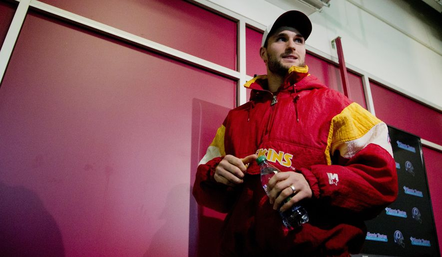 Washington Redskins quarterback Kirk Cousins leaves at the conclusion of a news conference at the Redskins Park in Ashburn, Va., Wednesday, Jan. 6, 2016. Cousins is wearing a jacket he said he purchased online last year.  (AP Photo/Manuel Balce Ceneta)