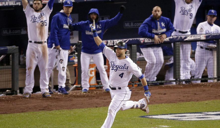 FILE - In this Oct. 27, 2015, file photo, Kansas City Royals' Alex Gordon celebrates a solo home run off New York Mets relief pitcher Jeurys Familia during the ninth inning of Game 1 of the Major League Baseball World Series, in Kansas City, Mo. A person familiar with the deal says All-Star outfielder Alex Gordon has agreed to a four-year contract to remain with the World Series champion Royals. The person spoke to The Associated Press on condition of anonymity Wednesday, Jan. 6, 2016,  because the team had not announced the deal. MLB.com was first to report the deal, expected to be worth $72 million. (AP Photo/Charlie Riedel, File)