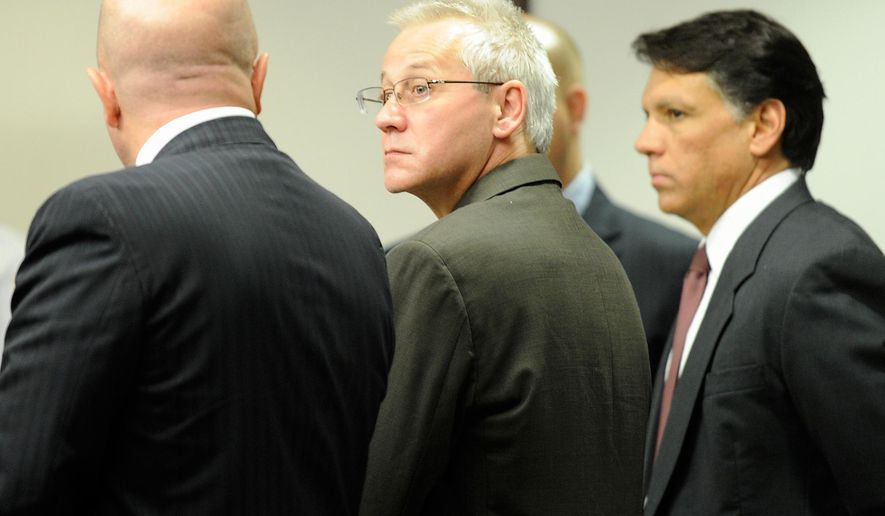 FILE - In this Thursday, April 19, 2012, file photo, Oscar Ray Bolin Jr., center, watches as the jurors walk into the courtroom  in Tampa. Bolin Jr,, who has been convicted 10 times for three separate slayings, is scheduled to die for one of them on Thursday, Jan. 7, 2016.  (Chris Urso/The Tampa Tribune via AP, Pool)