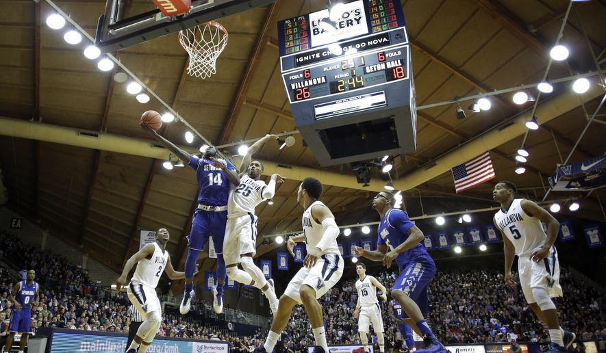 Seton Hall's Ismael Sanogo (14) goes up for a shot against Villanova's Mikal Bridges (25) during the first half of an NCAA college basketball game, Wednesday, Jan. 6, 2016, in Villanova, Pa. (AP Photo/Matt Slocum)