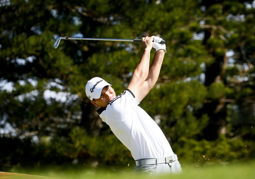Jason Day hits from the second tee during the Tournament of Champions golf pro-am, Wednesday, Jan. 6, 2016, at Kapalua Plantation Course on Kapalua, Hawaii. (AP Photo/Matt York)
