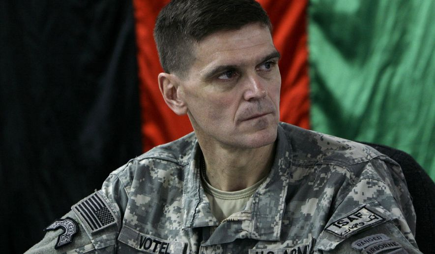 In this Feb. 24, 2007, photo, then-U.S. Brig. Gen. Joseph Votel listens in front of an Afghan national flag during a meeting with Afghan officials in an Afghan military base in Kabul, Afghanistan. A senior U.S. defense official says President Barack Obama is expected to choose Army Gen. Joseph Votel, commander of U.S. Special Operations Command, to succeed Army Gen. Lloyd Austin.  (AP Photo/Musadeq Sadeq, File)