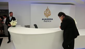Visitors wait in the lobby of Al Jazeera America after the network's first broadcast on Tuesday, Aug. 20, 2013 in New York. The Qatar-based Al-Jazeera Media Network launched its U.S. outlet only eight months after announcing the new venture, which on Tuesday replaced Al Gore's Current TV in more than 45 million TV homes.   (AP Photo/Bebeto Matthews)