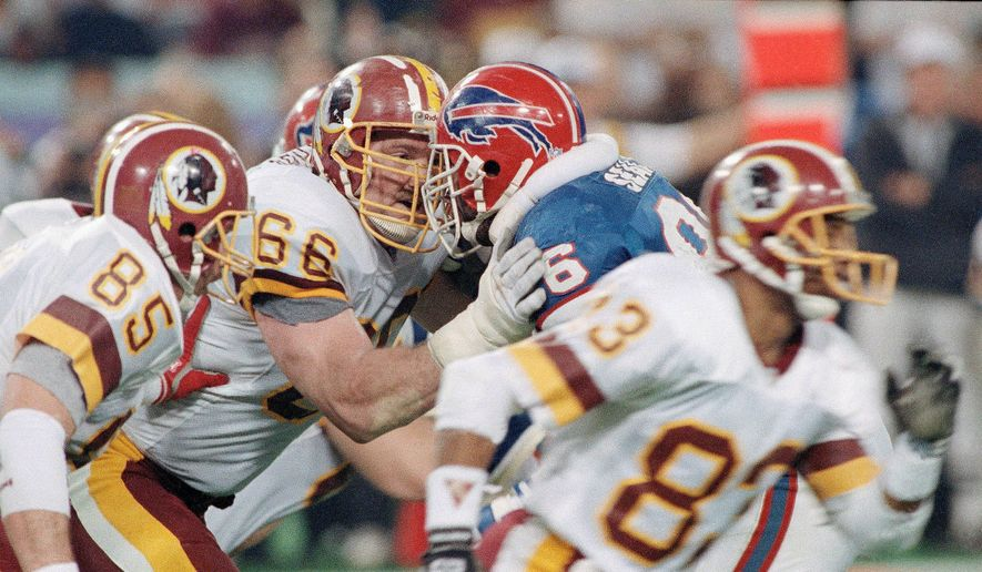 Washington Redskins' Joe Jacoby (66) butts heads at the line with Bills Leon Seals during Super Bowl XXVI against the Buffalo Bills, Sunday, Jan. 27, 1992 in Minneapolis. The 310 pound offensive tackle is one of the players responsible for the Redskins successful 1991 season and Super XXVI victory over the Bills. (AP Photo/Rusty Kennedy) **FILE**