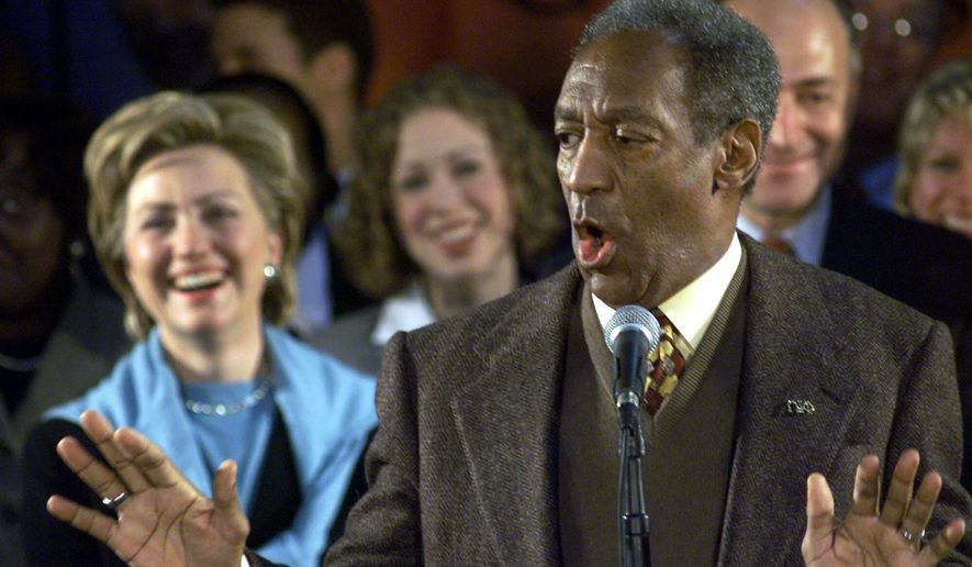 U.S. Senate candidate Hillary Rodham Clinton (left) laughs as Bill Cosby speaks during a campaign stop at Buffalo State College in Buffalo, N.Y., on Nov. 6, 2000. (Associated Press) **FILE**