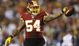 Washington Redskins linebacker Mason Foster (54) celebrates after a play during the second half of an NFL football game against the Dallas Cowboys in Landover, Md., Monday, Dec. 7, 2015. (AP Photo/Patrick Semansky)