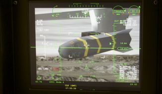 An unmanned aerial vehicle's Predator Hellfire missile is shown on a simulator's virtual camera at the March Air Reserve Base in Riverside County, Calif., June 25, 2008. (Associated Press)