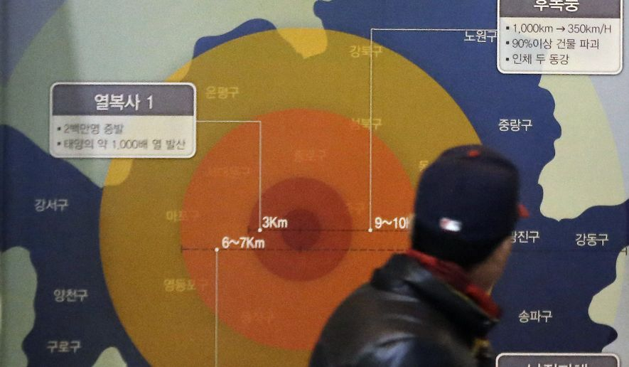 "A visitor looks at a display illustrating the damage a 1MT class nuclear weapon would cause if detonated in Seoul, at the Korea War Memorial Museum in Seoul, South Korea, Thursday, Jan. 7, 2016. The United States, South Korea and Japan agreed to launch a ""united and strong"" international response to North Korea's apparent fourth nuclear test, as experts scrambled Thursday to find more details about the detonation that drew worldwide skepticism and condemnation. (AP Photo/Ahn Young-joon)"