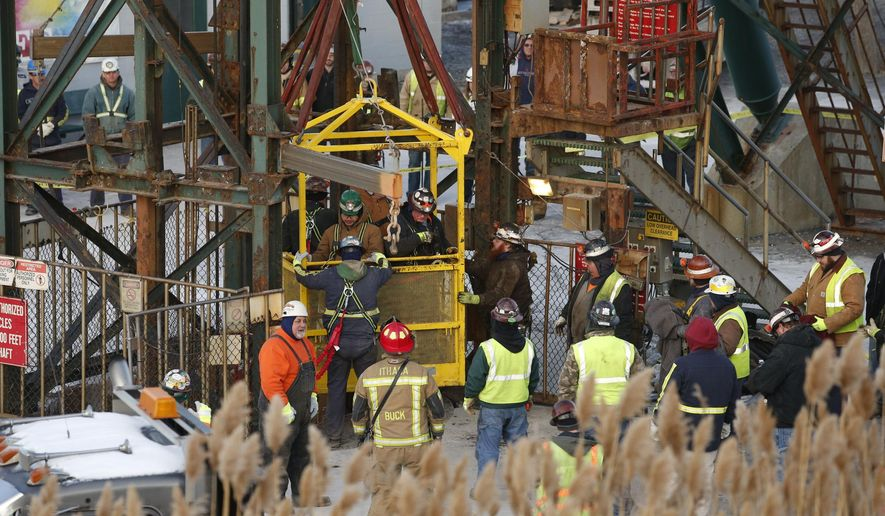 The fourth group of workers emerge from an elevator Thursday, Jan. 7, 2016, after they were stuck overnight in a shaft at the Cayuga Salt Mine in Lansing, N.Y. Cargill Inc. spokesman Mark Klein said all 17 miners have been rescued. (Simon Wheeler/The Ithaca Journal via AP, Pool)
